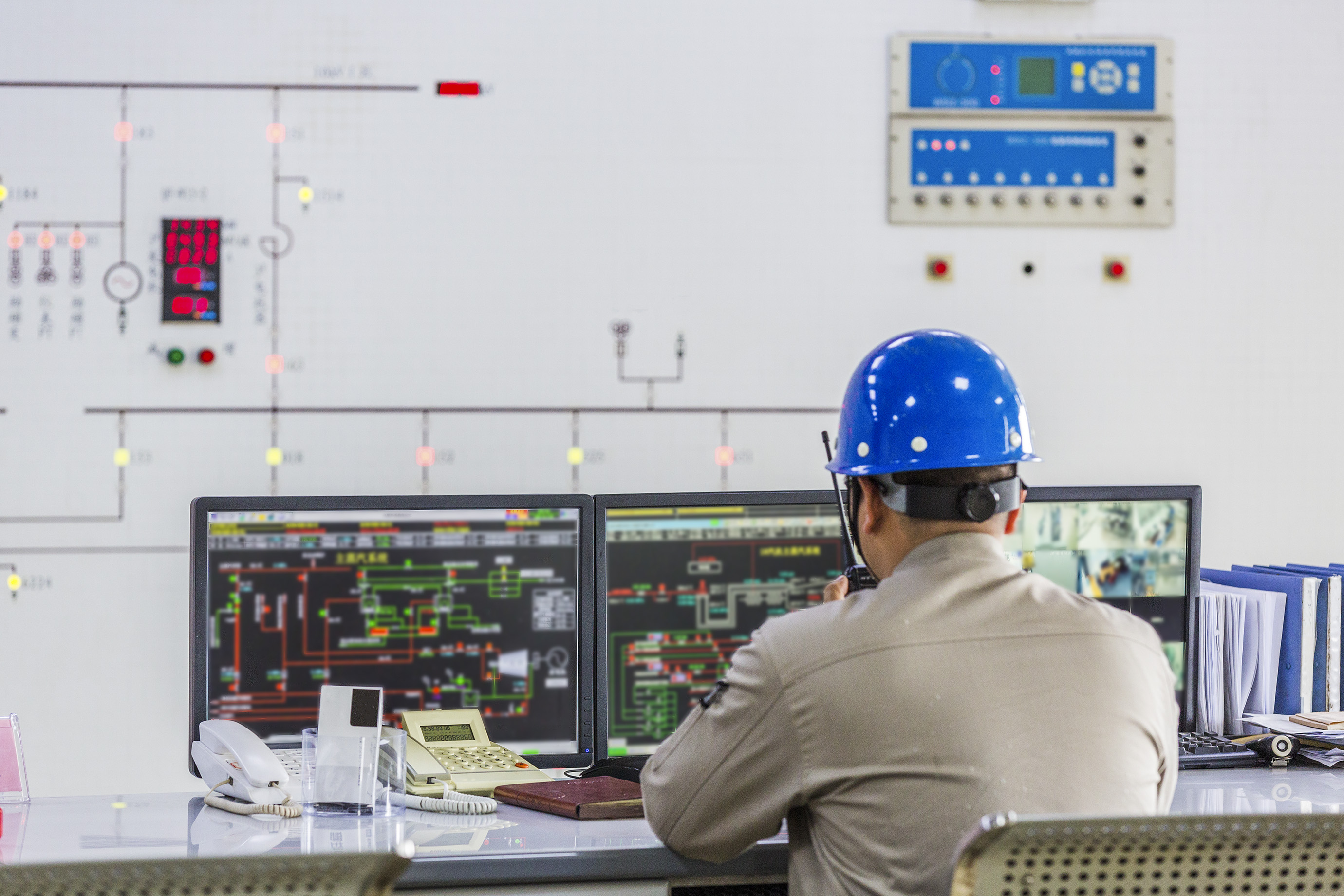 workers in control room of a factory.